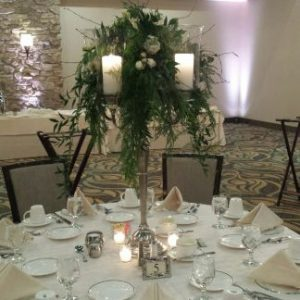greenery topper on silver candelabra centerpiece